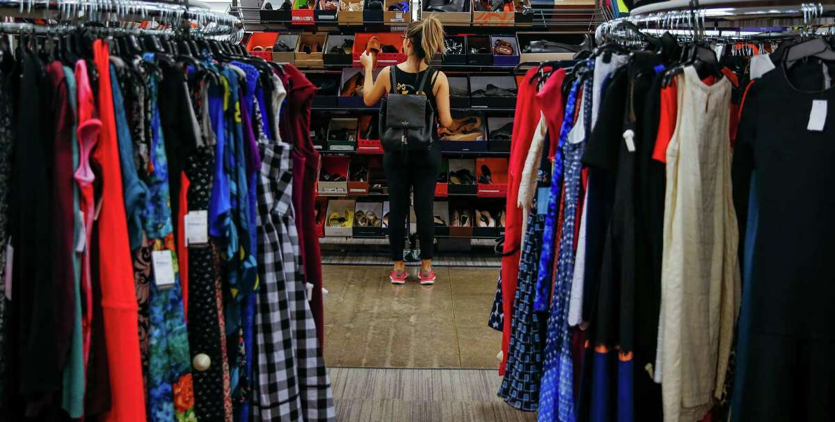 """Jessica Le shops for shoes at Nordstrom Rack Monday, Oct. 31, 2016 in Houston. """"There's some things that I would shop at Nordstrom for,"""" Le said. """"But I just know that in a couple of months it will end up here.""""( Michael Ciaglo / Houston Chronicle )"""