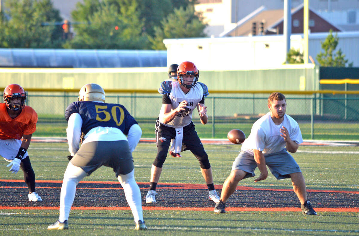 Edwardsville quarterback Brenden Dickmann takes the snap during Monday's seven-on-seven scrimmage against Althoff at EHS.