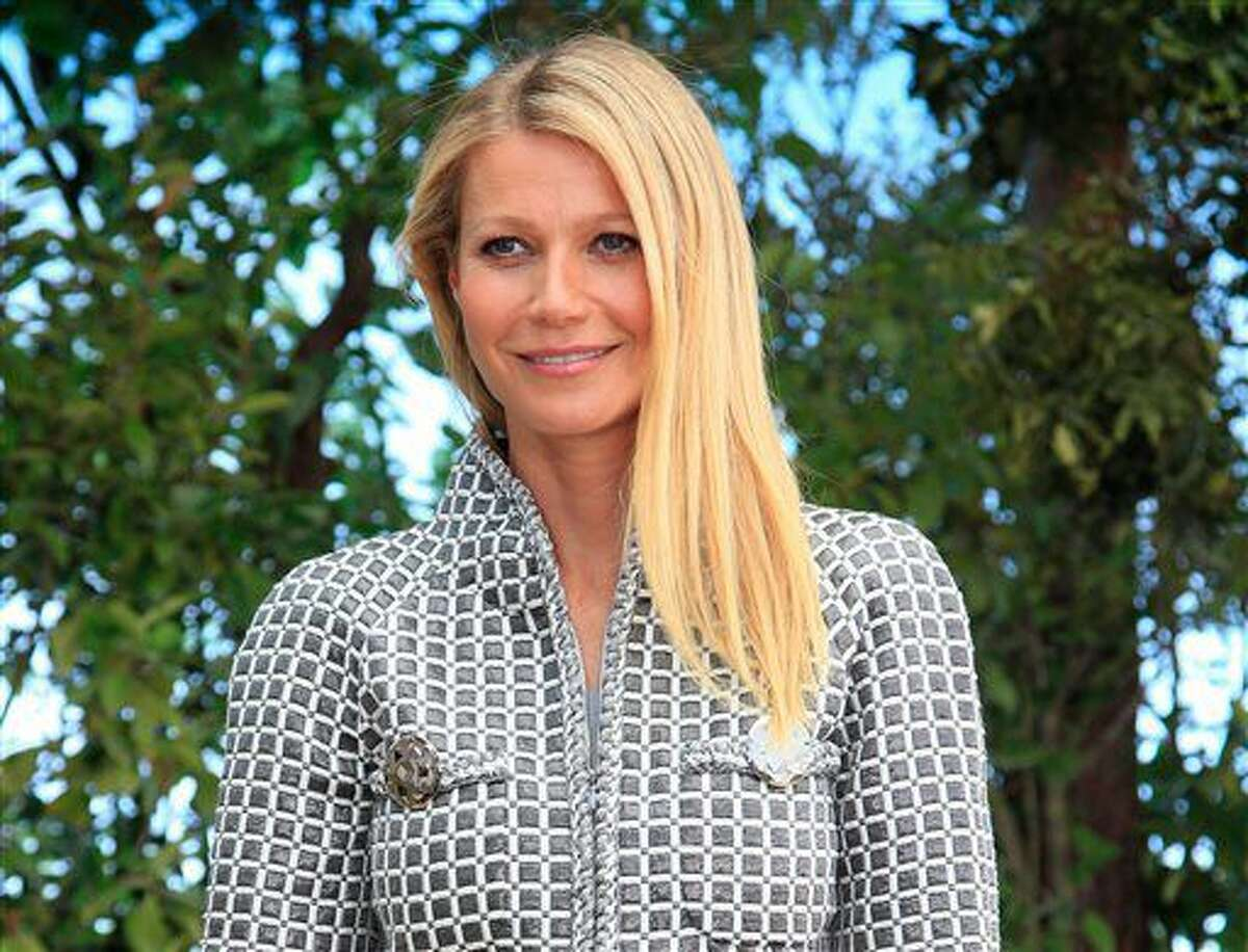 In this Jan. 26, 2016, file photo, actress Gwyneth Paltrow poses for photographers before Chanel's Spring-Summer 2016 Haute Couture fashion collection in Paris. Paltrow, Ashton Kutcher and