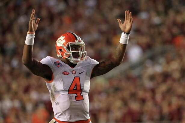 TALLAHASSEE, FL - OCTOBER 29:  Deshaun Watson #4 of the Clemson Tigers celebrates a touchdown during a game against the Florida State Seminoles at Doak Campbell Stadium on October 29, 2016 in Tallahassee, Florida.