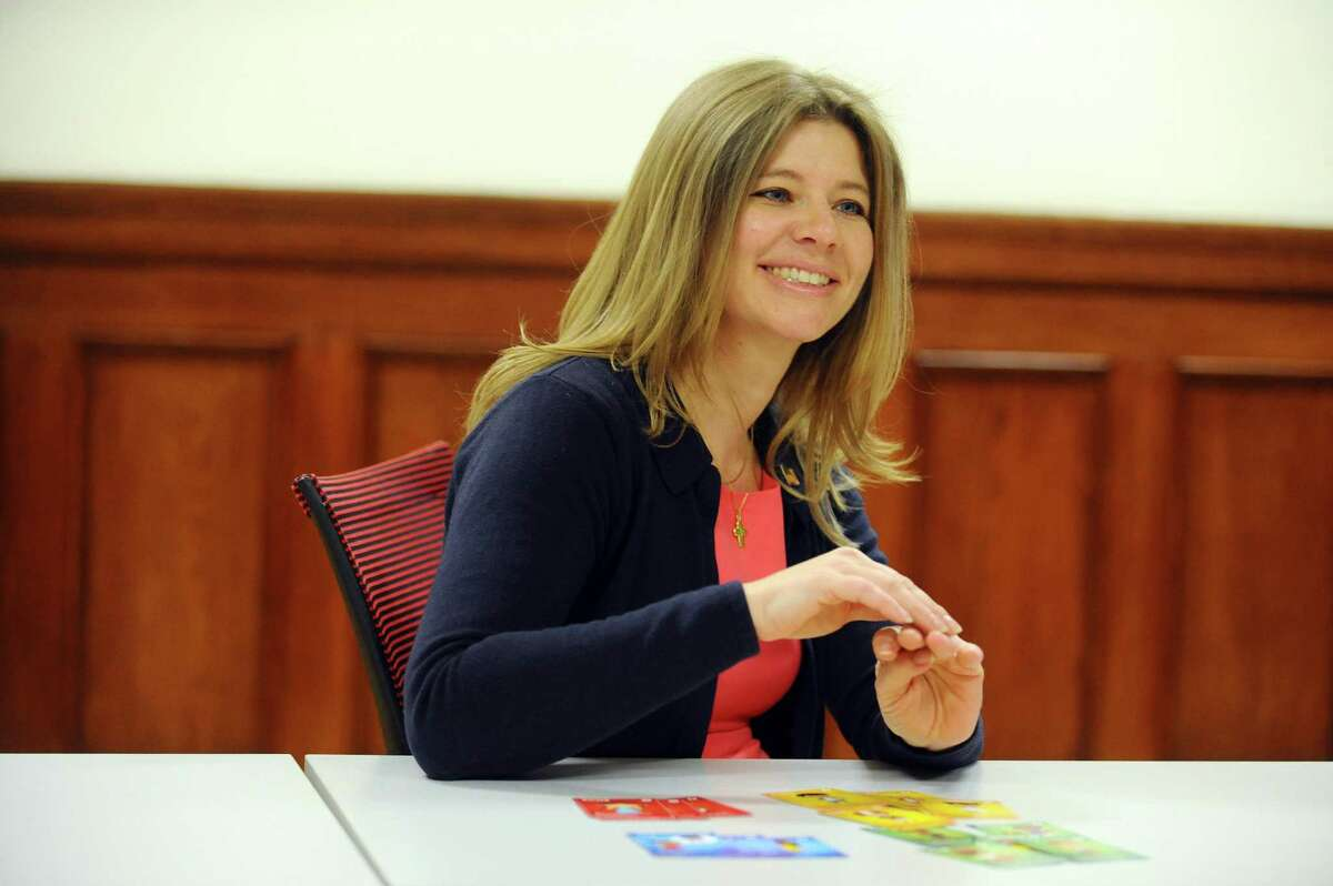 Theresa Robbins shows off her Lovesnax cards, which are emotional vocabulary cards that fit into a child's lunchbox to help them cope with feelings, inside the Stamford Innovation Center in downtown Stamford, Conn. on Thursday, Oct. 27, 2016.