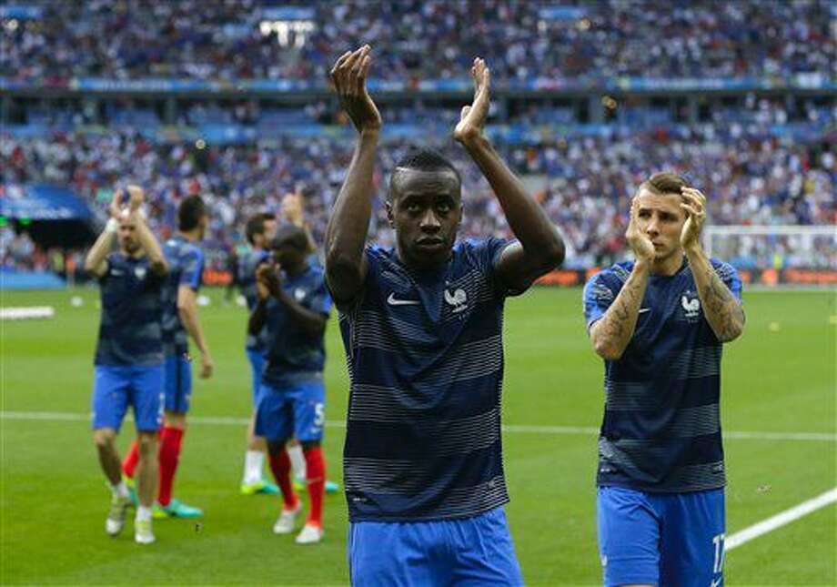 France's Blaise Matuidi, center and Lucas Digne, right, salute fans before the Euro 2016 final soccer match between Portugal and France at the Stade de France in Saint-Denis, north of Paris, Sunday, July 10, 2016. (AP Photo/Thanassis Stavrakis) Photo: Thanassis Stavrakis