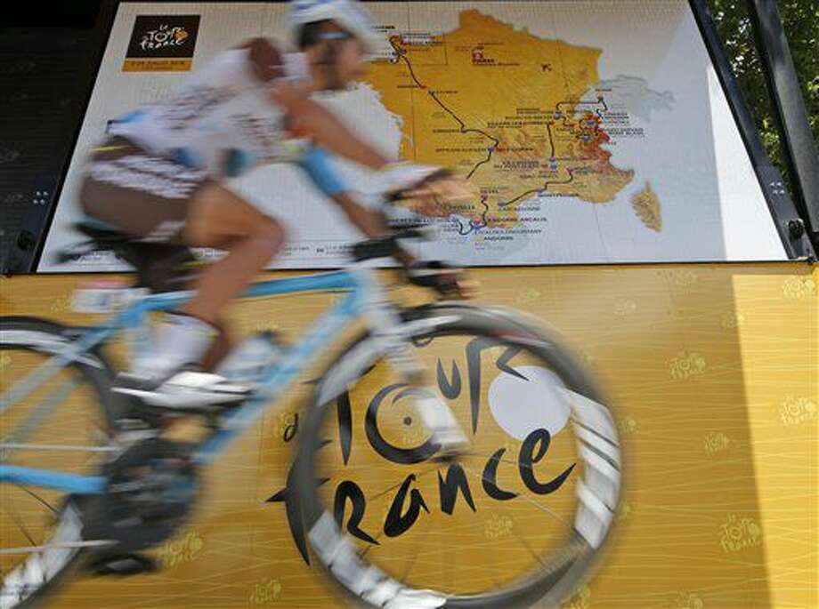 a rider passes a map of the 2016 race itinerary after signing the start list prior to the eleventh stage of the Tour de France cycling race over 162.5 kilometers (100.7 miles) with start in Carcassonne and finish in Montpellier, France, Wednesday, July 13, 2016. (AP Photo/Christophe Ena) Photo: Christophe Ena