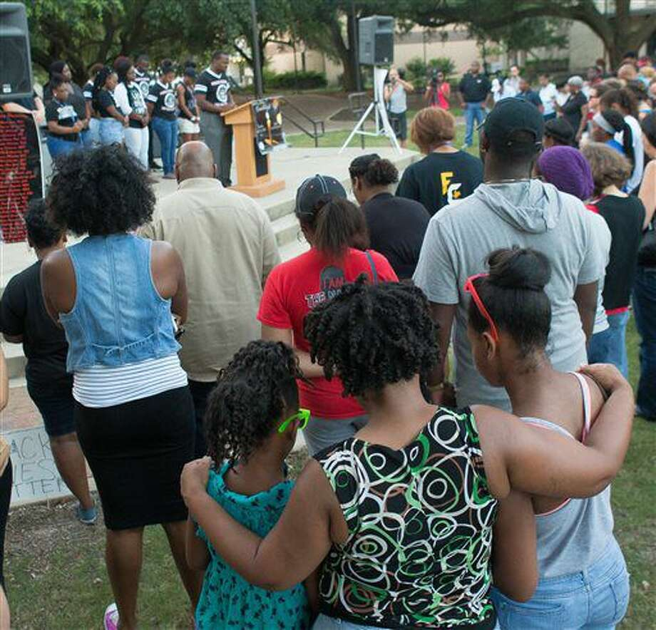 The NAACP at McNeese State University in Lake Charles, La., held a prayer vigil on Tuesday, July 12, 2016, in the Quad on campus. The vigil was to promote unity and equality and comes in the wake of recent shootings in Baton Rouge, Dallas, and Minnesota. (Rick Hickman/Lake Charles American Press via AP) Photo: Rick Hickman