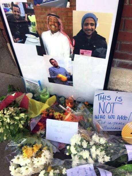 Photos decorate a memorial for Hussain Saeed Alnahdi, 24, who died Monday after being assaulted on a major thoroughfare in downtown Menomonie, Wis.. Photo: Karen Herzog, MBR / Milwaukee Journal Sentinel