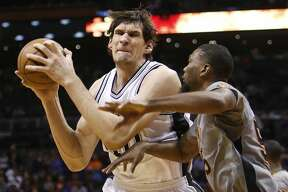 FILE - In this Jan. 21, 2016, file photo, San Antonio Spurs center Boban Marjanovic, left, works the ball inside during the third quarter of an NBA basketball game against the Phoenix Suns in Phoenix. The Detroit Pistons have signed Marjanovic to a $21 million, three-year contract, the team announced Tuesday, July 2, 2016. (AP Photo/Rick Scuteri, File)