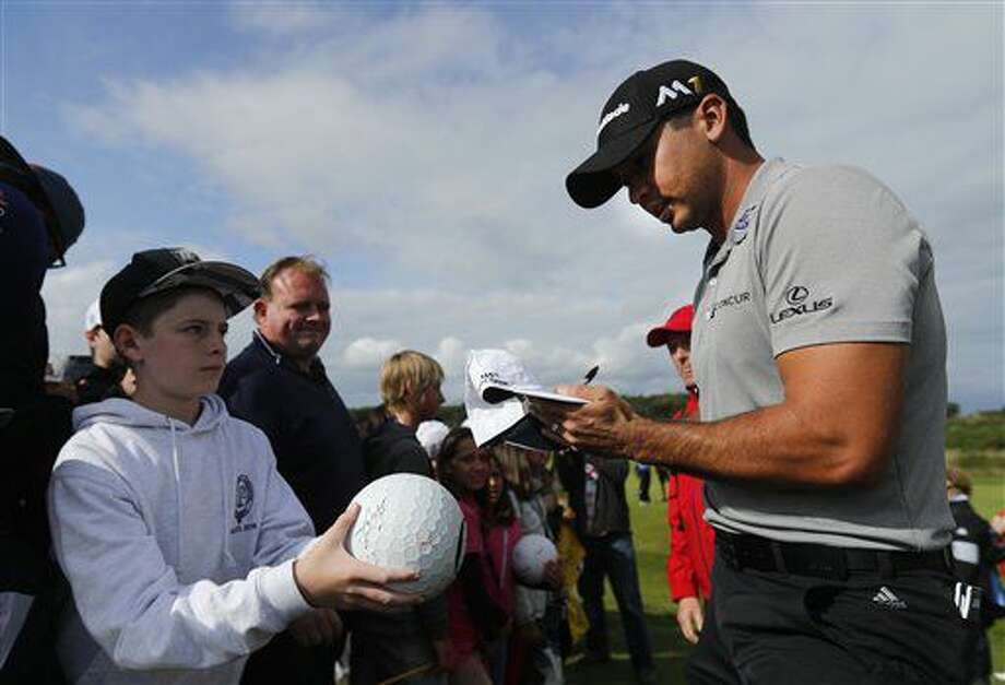 Jason Day of Australia signs autographs as he walks off the 12th green during a practice round ahead of the British Open Golf Championship at the Royal Troon Golf Club in Troon, Scotland, Tuesday, July 12, 2016. The Open starts Thursday. (AP Photo/Ben Curtis) Photo: Ben Curtis