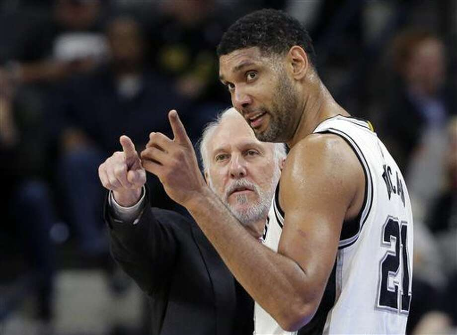 FILE - In this Dec. 2, 2015, file photo, San Antonio Spurs head coach Gregg Popovich, left, talks with forward Tim Duncan (21) during the second half of an NBA basketball game against the Milwaukee Bucks in San Antonio. They were joined at the hip for 19 years, a player and coach combination that enjoyed more wins than any in NBA history. And now that Duncan's playing days are done, Popovich is about to start anew in some respects. (AP Photo/Eric Gay, File0 Photo: Eric Gay