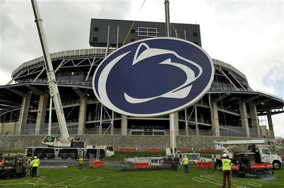 "FILE - In this May 15, 2014 file photo, a logo is lifted by crane to the back of a scoreboard at Penn State's Beaver Stadium in State College, Pa. Judge Gary Glazer is expected to release records Tuesday, July 12, 2016, that also may contain details about claims Penn State assistant coaches saw ""inappropriate contact"" and ""sexual contact"" between Sandusky and a child in 1987 and 1988.(AP Photo/Centre Daily Times, Nabil K. Mark) MANDATORY CREDIT MAGS OUT Photo: Nabil K. Mark"