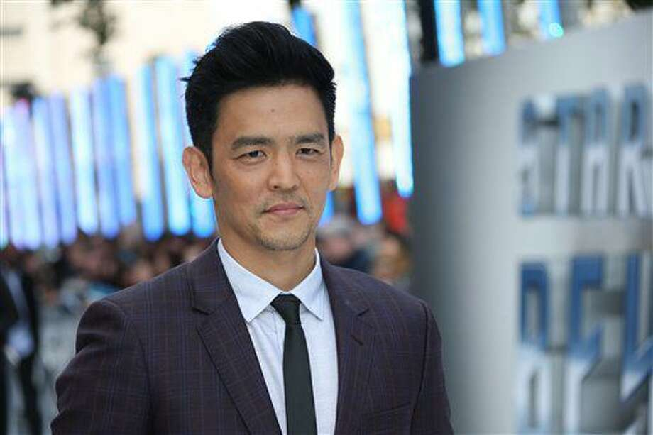 Actor John Cho poses for photographers upon arrival at the premiere of the film 'Star Trek Beyond' in London, Tuesday, July 12, 2016. (Photo by Joel Ryan/Invision/AP) Photo: Joel Ryan