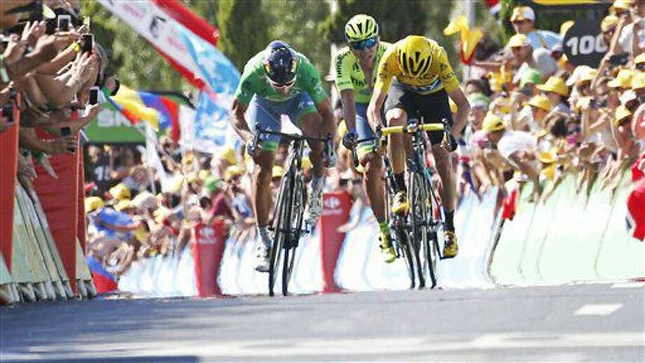 Stage winner Peter Sagan of Slovakia, wearing the best sprinter's green jersey, and Britain's Chris Froome, wearing the overall leader's yellow jersey, sprint towards the finish line of the eleventh stage of the Tour de France cycling race over 162.5 kilometers (100.7 miles) with start in Carcassonne and finish in Montpellier, France, Wednesday, July 13, 2016. (AP Photo/Christophe Ena) Photo: Christophe Ena