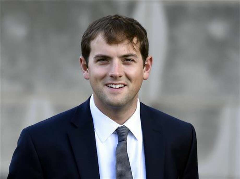 """FILE - In this Oct. 29, 2014 file photo, Luke Russert arrives for the funeral service for Ben Bradlee at the National Cathedral in Washington. Russert, son of the late """"Meet the Press"""" moderator Tim Russert, says that he's leaving NBC News to take some time away from political reporting. His announcement Wednesday came on the eve of the national political conventions. (AP Photo/Susan Walsh, File) Photo: Susan Walsh"""