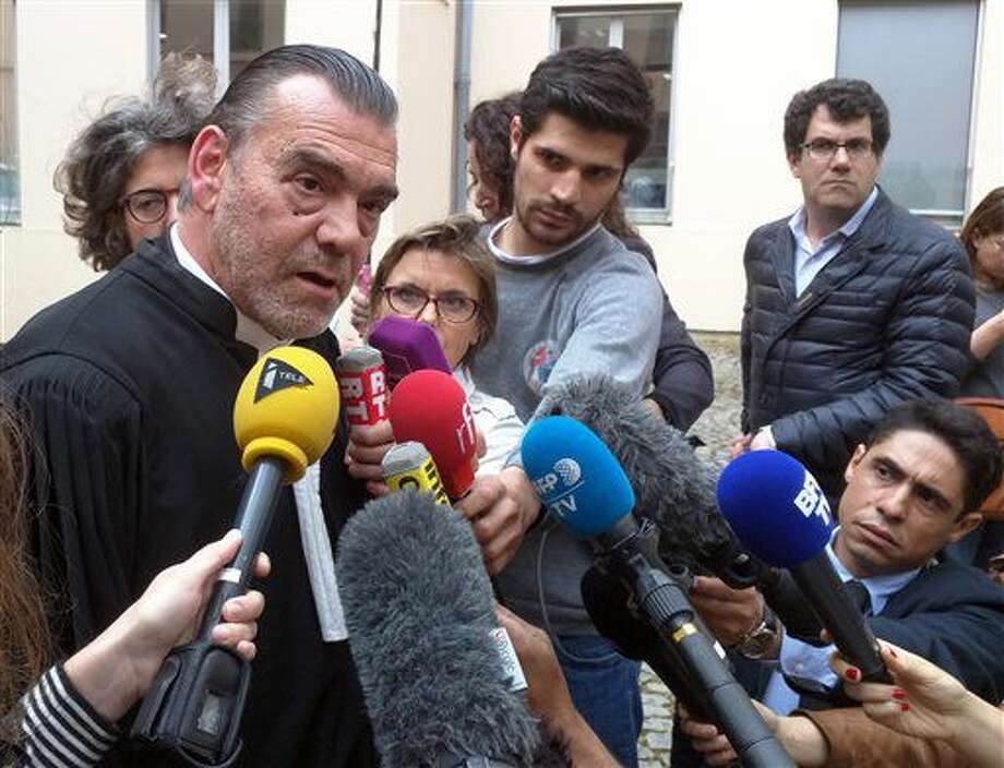 Lawyer Frank Berton, left, who represents Paris attacks suspect Salah Abdeslam, speaks to journalists outside an administrative tribunal in the Parisian suburb of Versailles, France, Wednesday, July 13, 2016. Berton is appealing to the tribunal to have two live video cameras removed from Abdeslam's cell in the French prison of Fleury-Merogis, saying they risk damaging him psychologically. (AP Photo/Raphael Satter) Photo: Raphael Satter