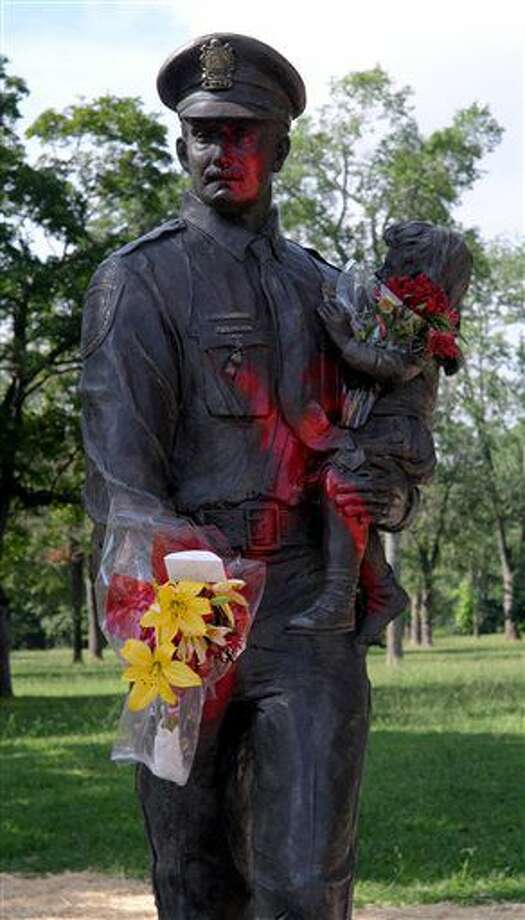 The Richmond Police Memorial statue in Richmond, Va., was vandalized Wednesday, July 12, 2016, with graffiti referring to Alton Sterling, who was killed by a police officer in Baton Rouge, La. The statue was only recently moved to its new location in Byrd Park from the original site in downtown Richmond. ( Bob Brown/Richmond Times-Dispatch via AP) Photo: Bob Brown