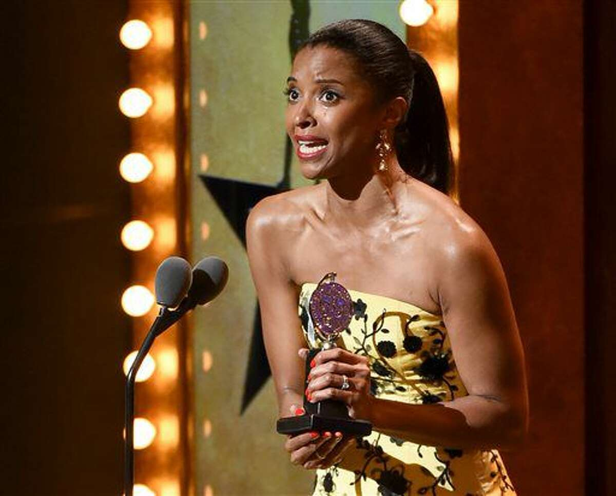 """FILE - In this June 12, 2016 file photo, Renee Elise Goldsberry accepts the award for featured actress in a musical for """"Hamilton"""" at the Tony Awards in New York. Goldsberry, who plays Angelica Schuyler, will leave the musical sometime this fall, her representative confirmed. (Photo by Evan Agostini/Invision/AP, File)"""