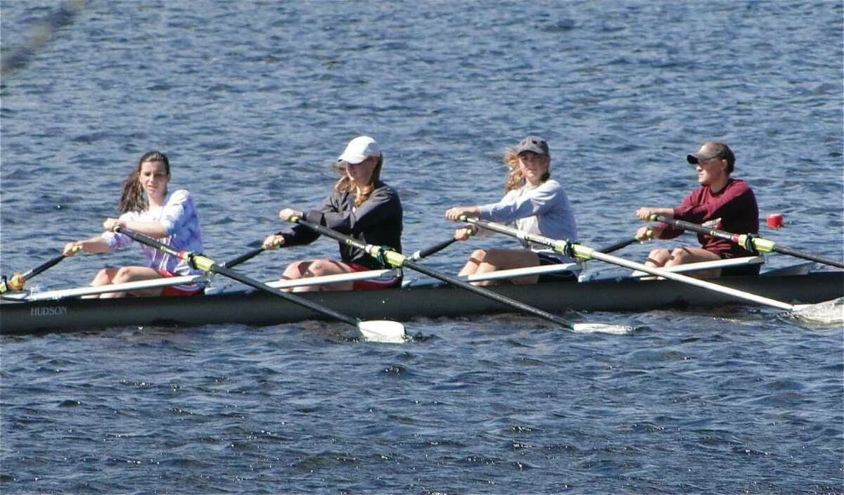 New Canaan crew women's varsity quad -- featuring, from left, Stephanie Winsch, Mackenzie Bess, Marianne Hoeft and Jennifer DeCata -- captured first place at regionals and will be heading for nationals along with 24 additional teammates. Photo by Ricardo Viera for the New Canaan News.