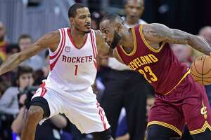 Cleveland Cavaliers forward LeBron James (23) drives on Houston Rockets forward Trevor Ariza (1) in the first half of an NBA basketball game Tuesday, Nov. 1, 2016, in Cleveland. (AP Photo/DavidDermer)