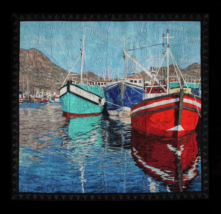 """Cynthia England of Dickinson, Texas, won the event's top prize, the Handi Quilter Best of Show Award, which includes a prize of $12,500, for her quilt, """"Reflections of Cape Town."""" Photo: International Quilt Festival"""