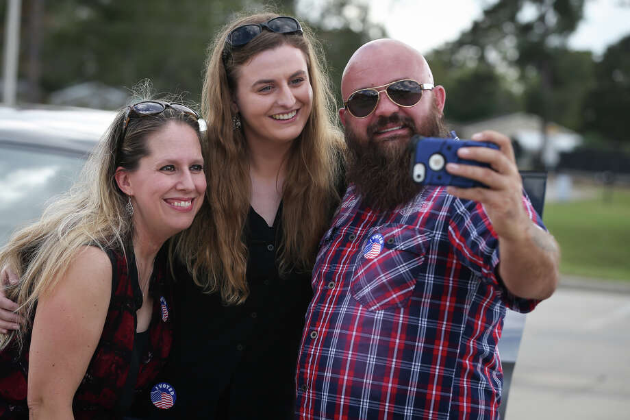 Willis residents William Chapman, originally from Scotland, right, his wife Michah, who was his online penpal for three years, and Sgt. Shoshana Lyttle, now a Montgomery resident but originally from England, take a photo together after voting on Saturday at the North Montgomery County Community Center in Willis. Photo: Michael Minasi, Staff / © 2016 Houston Chronicle