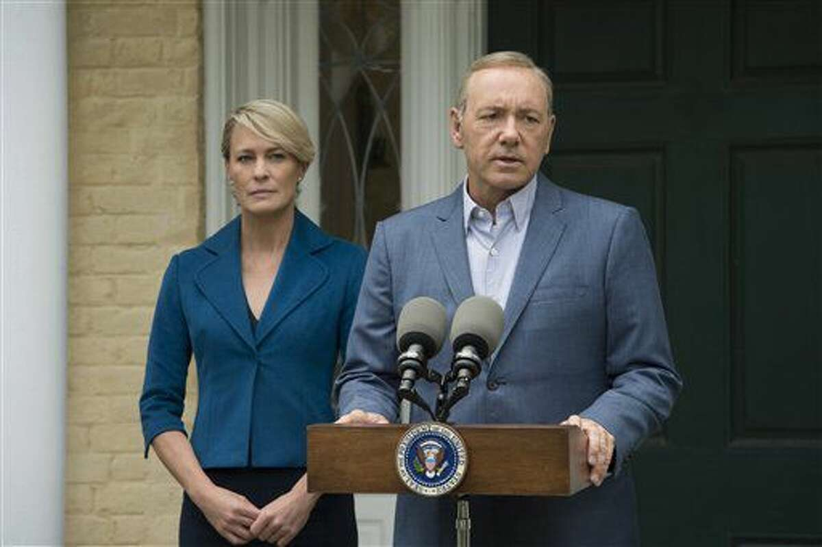 FILE - An undated image shows actress Robin Wright alongside actor Kevin Spacey in the hit Netflix series