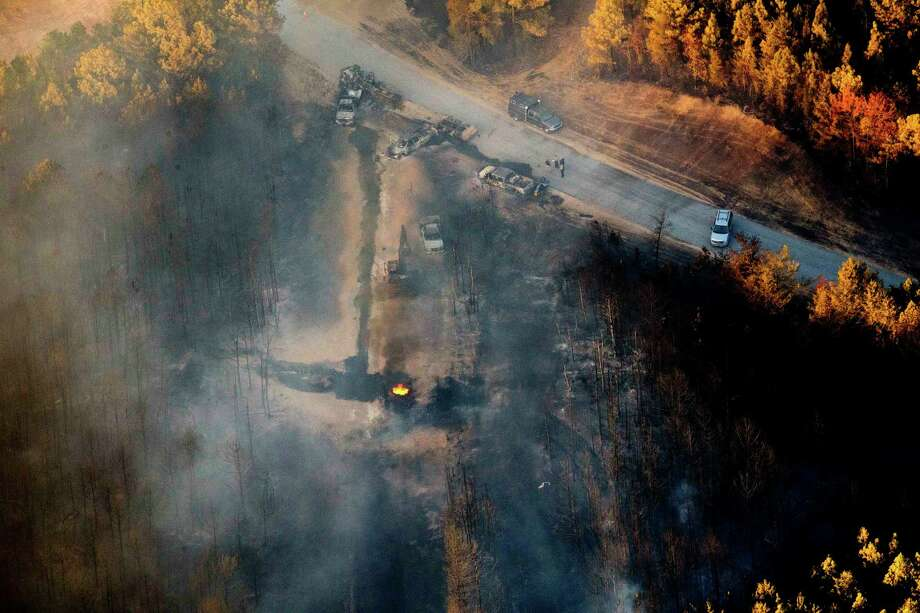 A flame burns Tuesday after a Monday explosion of a pipeline near Helena, Ala., that killed a worker. The blast, which sent flames and thick black smoke soaring over the forest, happened a few miles from where the Colonial pipeline ruptured in September. Photo: Brynn Anderson, STF / Copyright 2016 The Associated Press. All rights reserved.
