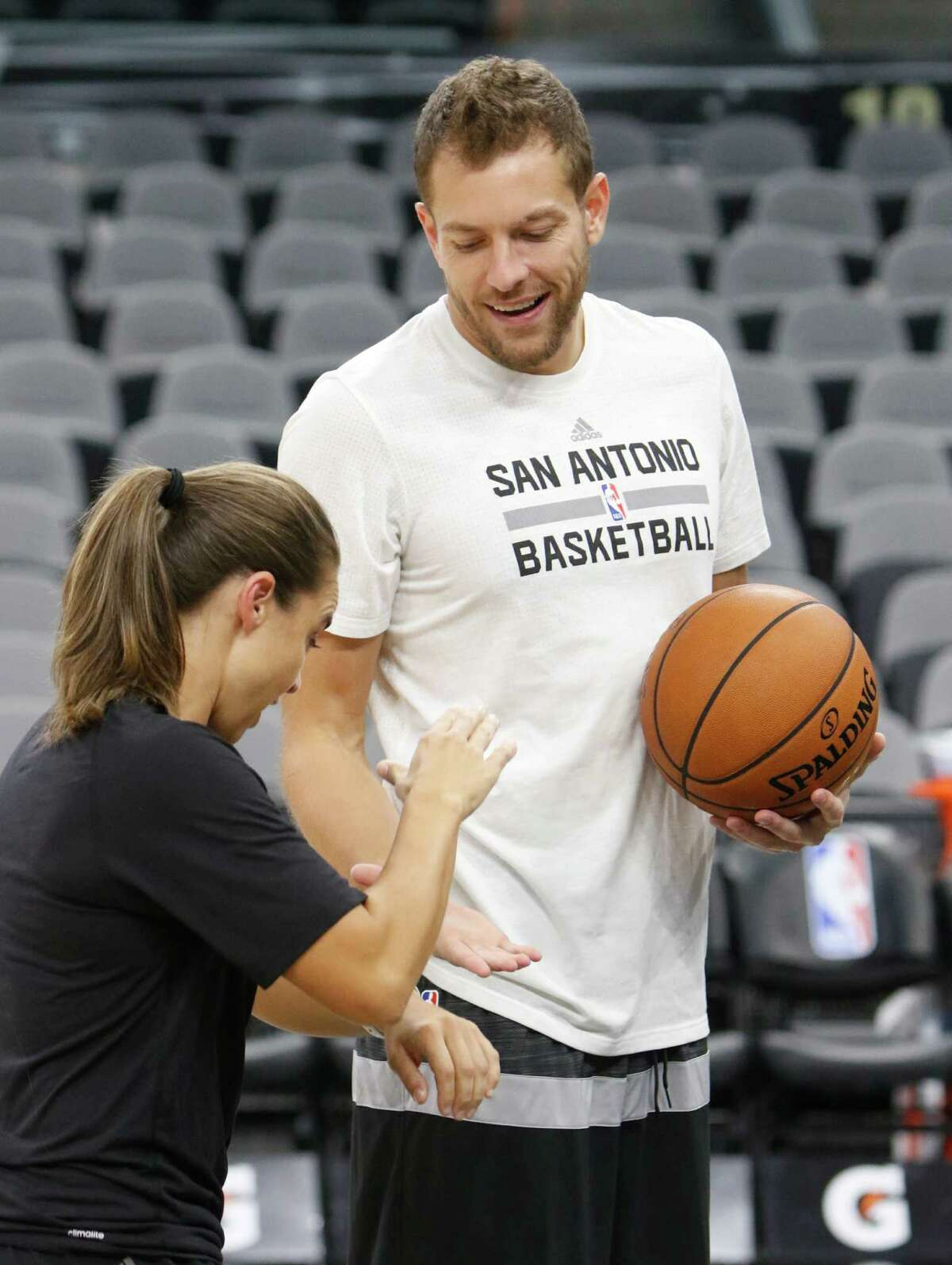 SAN ANTONIO,TX - NOVEMBER 01: David Lee #10 of the San Antonio Spurs is greeted by Assistant coach Becky Hammon before the game between Utah Jazz and the San Antonio Spurs at AT&T Center on November 1, 2016 in San Antonio, Texas. NOTE TO USER: User expressly acknowledges and agrees that , by downloading and or using this photograph, User is consenting to the terms and conditions of the Getty Images License Agreement.