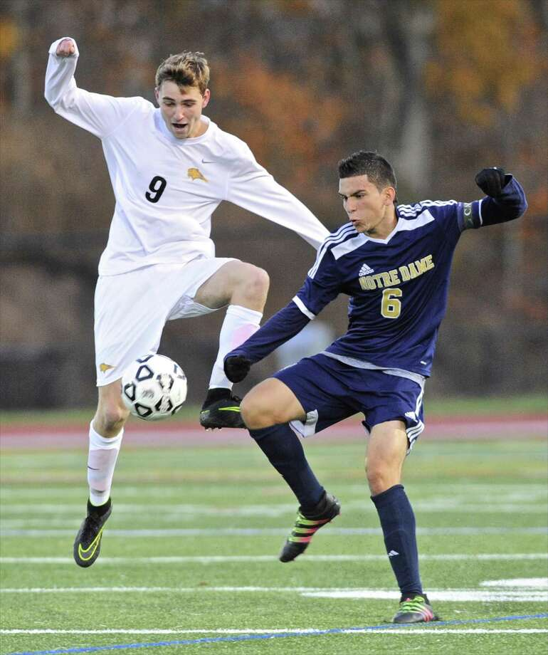 Brookfield's Sam Stueck (9) and Notre Dame's Max Cano (6) go for the ball in the SWC boys soccer semi final game between Notre Dame Fairfield and Brookfield high schools, on Tuesday, November 1, 2016, at Joel Barlow High School, Redding, Conn. Photo: H John Voorhees III / Hearst Connecticut Media / The News-Times