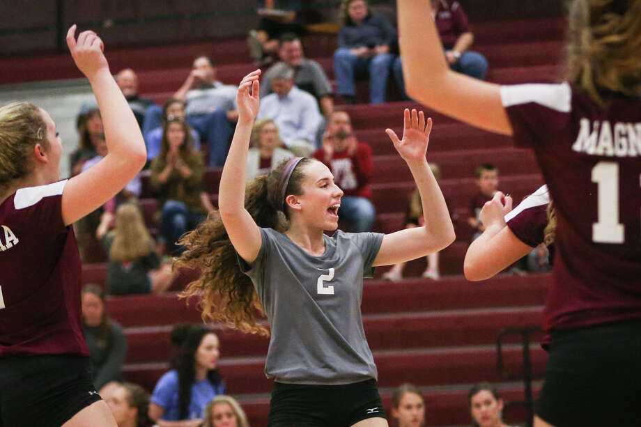 Magnolia's Paige Braswell (2) celebrates with teammates during the varsity volleyball game against Cedar Creek on Tuesday, Nov. 1, 2016, at A&M Consolidated High School. (Michael Minasi / Houston Chronicle) Photo: Michael Minasi, Staff / © 2016 Houston Chronicle