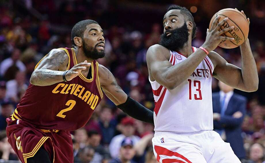 Rockets guard James Harden, right, mulls his options with the Cavaliers' Kyrie Irving on his flank in Tuesday night's game. The Cavaliers won 128-120 despite 41 points from Harden. Photo: David Dermer, FRE / AP 2016