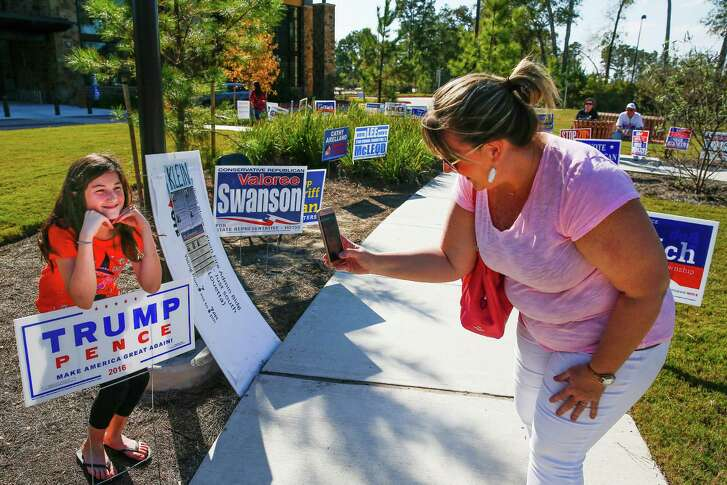 Susan Noski, right, takes a photo Monday of her daughter, Kamryn Noski, 10, outside Lone Star College Creekside Center before casting a ballot in Precinct 955, the top-voting precinct so far in Harris County.