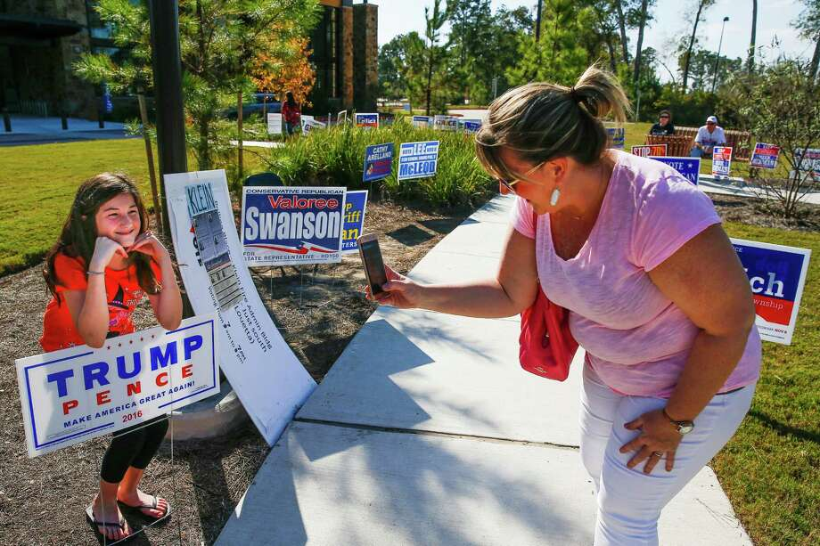 Susan Noski, right, takes a photo Monday of her daughter, Kamryn Noski, 10, outside Lone Star College Creekside Center before casting a ballot in Precinct 955, the top-voting precinct so far in Harris County. Photo: Michael Ciaglo, Staff / © 2016  Houston Chronicle