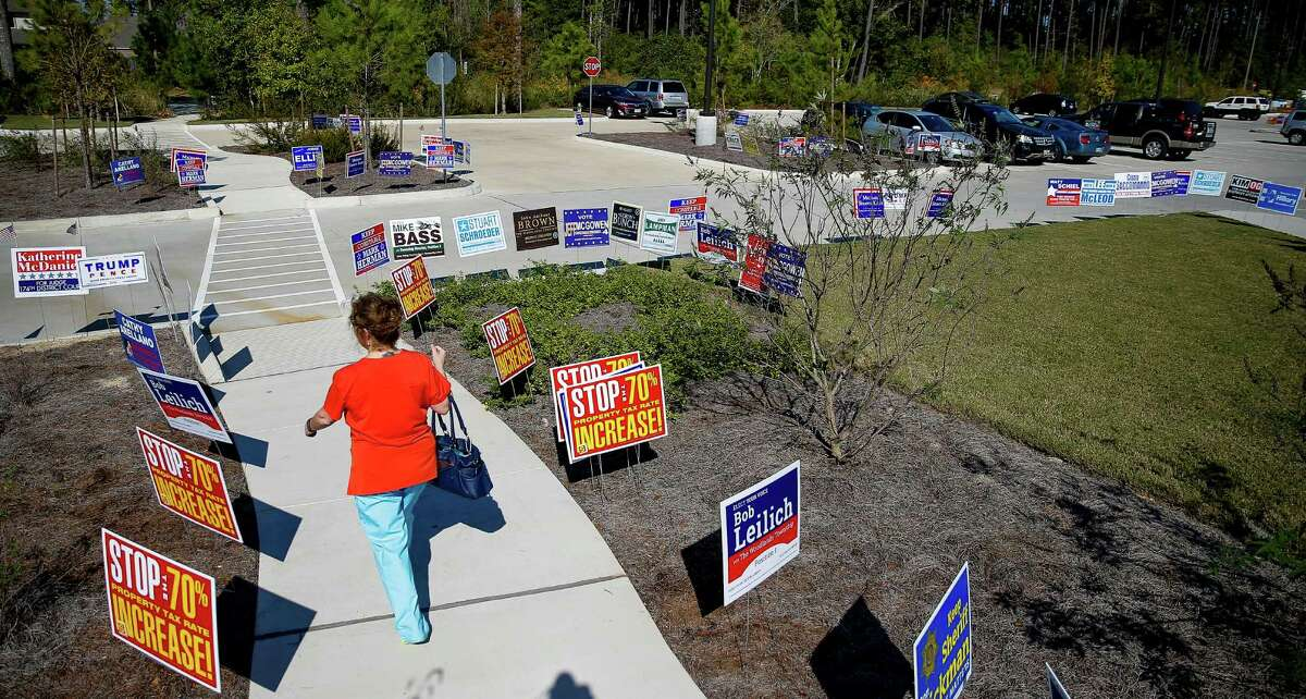 An early voter leaves Lone Star College Creekside Center on Monday after casting her ballot in Precinct 955. More than 40 percent of registered voters in that precinct cast a ballot during the first week of early voting.