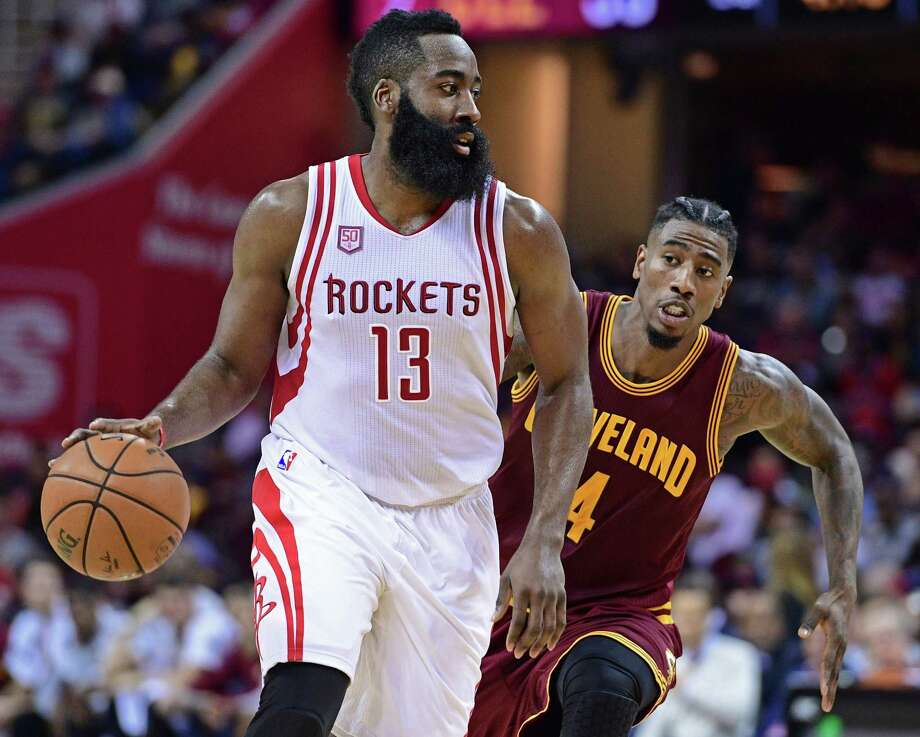 James Harden, left, tries to distance himself from the Cavaliers' Iman Shumpert in Tuesday night's game. Photo: David Dermer, FRE / AP 2016