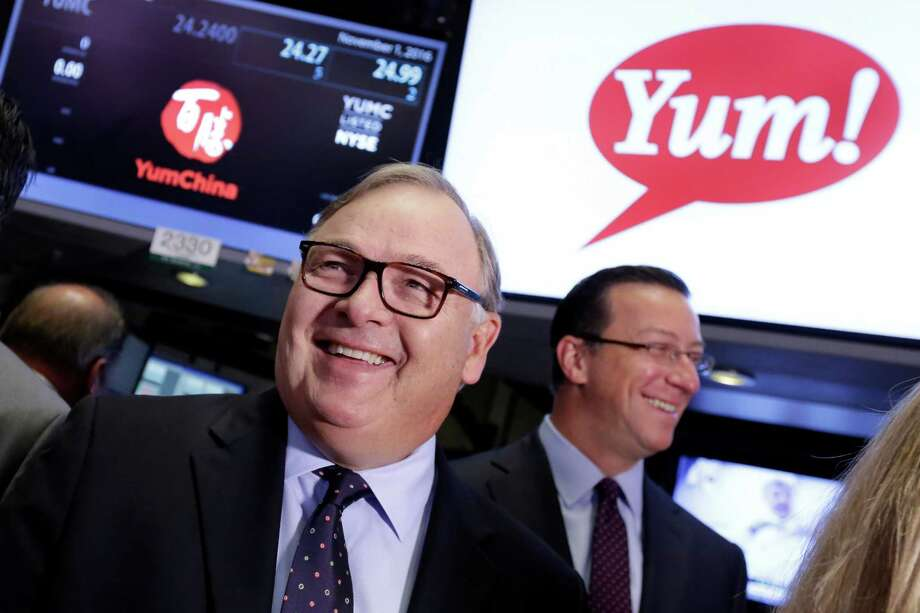 Yum! Brands CEO Greg Creed, left, visits the trading floor of the New York Stock Exchange, prior to ringing the opening bell, to mark the completion of the separation of Yum China Holdings, Inc. from Yum! Brands, Tuesday, Nov. 1, 2016. (AP Photo/Richard Drew) Photo: Richard Drew, STF / AP