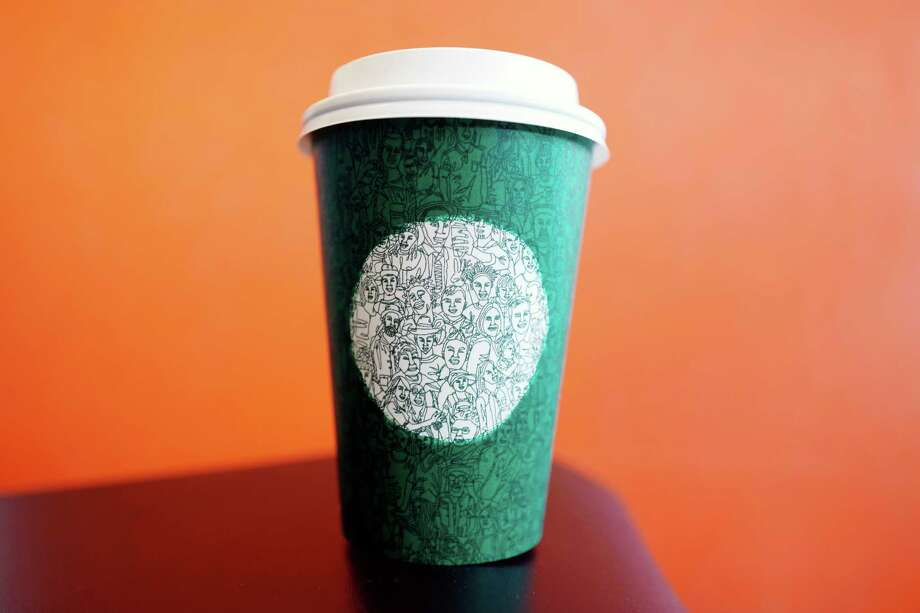 Starbucks' new green cup features a mosaic of more than 100 people. The cup made its debut Tuesday. Photo: Mark Lennihan, STF / Copyright 2016 The Associated Press. All rights reserved.