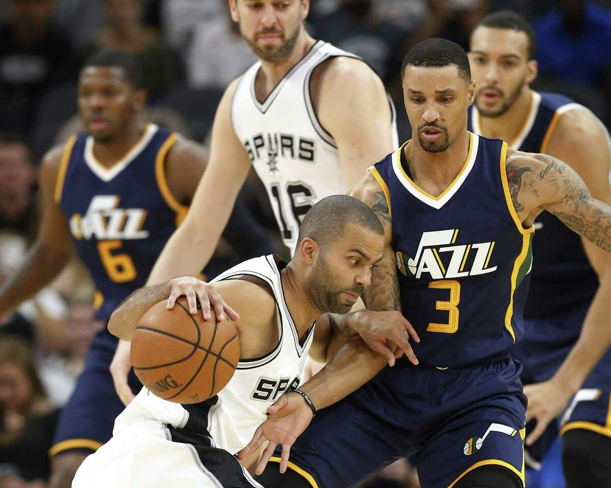 Spurs' Tony Parker attempts to drive to the lane against the Utah Jazz's George Hill at the AT&T Center on Nov. 1, 2016.