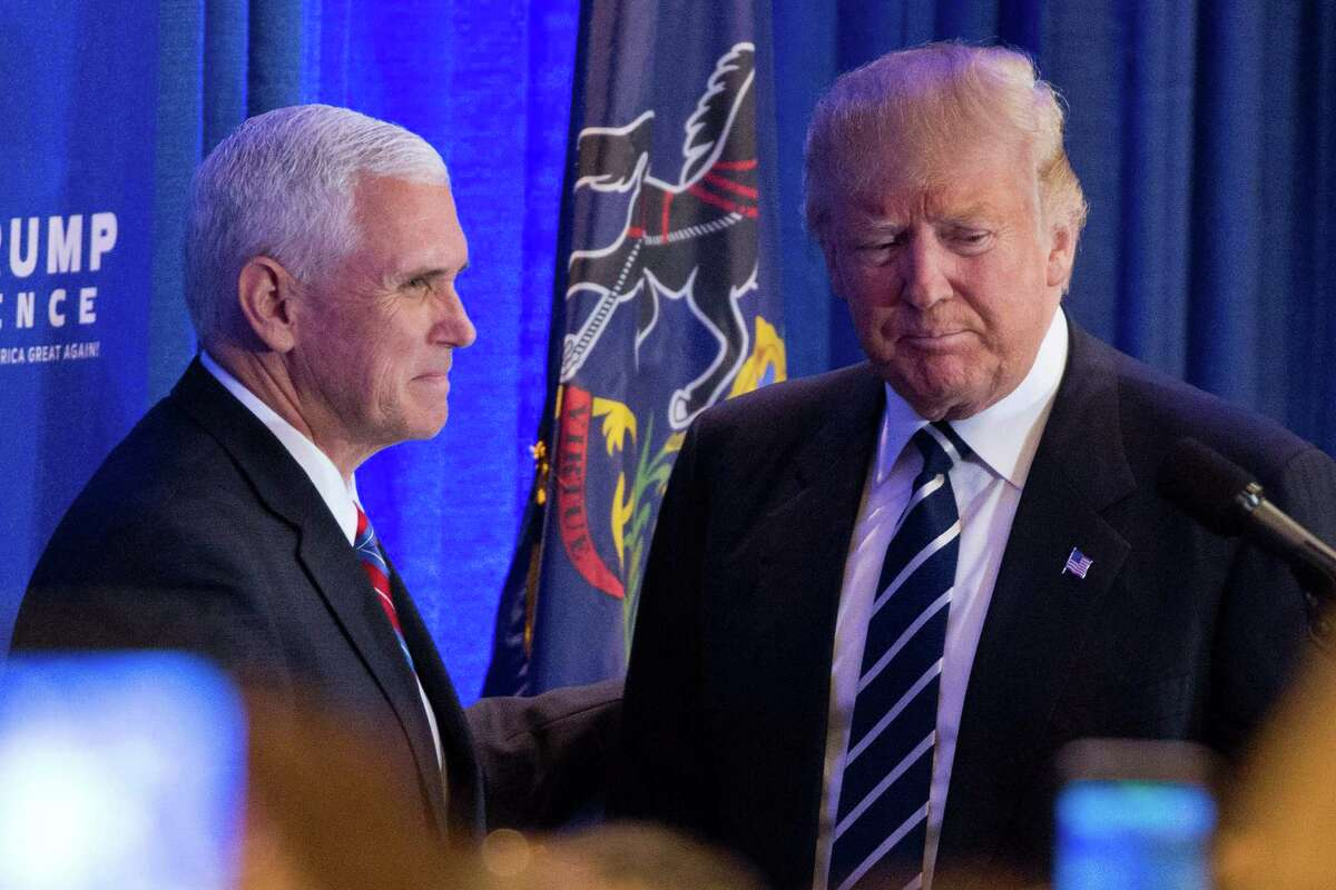 Republican presidential nominee Donald Trump greets his running mate Mike Pence before speaking at a private gathering in King of Prussia, Pennsylvania on November 1, 2016. / AFP PHOTO / DOMINICK REUTERDOMINICK REUTER/AFP/Getty Images