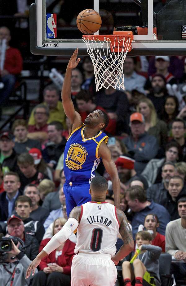 Warriors guard Ian Clark shoots over Portland's Damian Lillard during the second half. Clark had 22 points, 11 of them during a 20-4 Golden State run at the end of the 1st quarter. Photo: Craig Mitchelldyer, Associated Press
