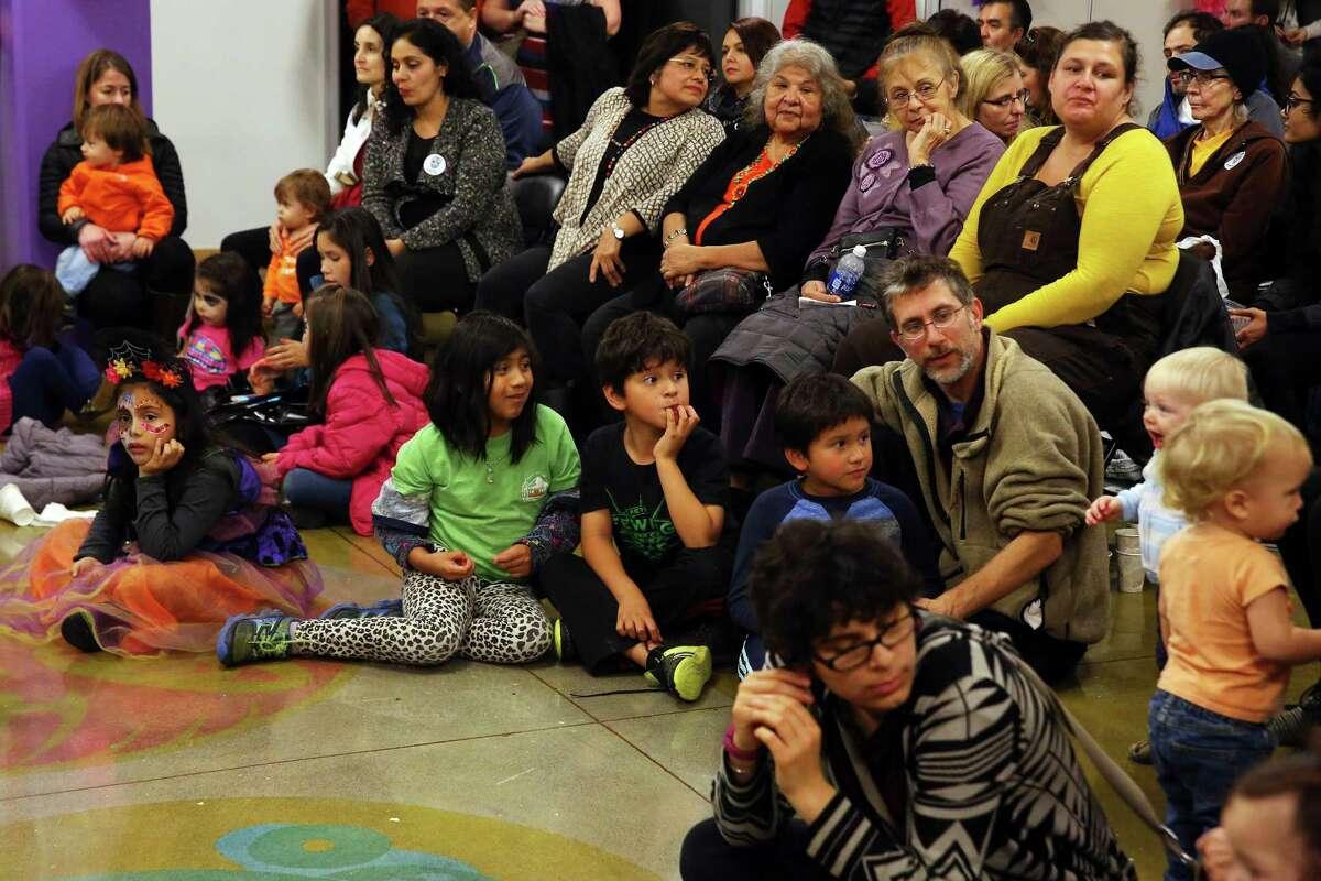 People take part in the 12th annual Dia de los Muertos celebration at El Centro de la Raza.