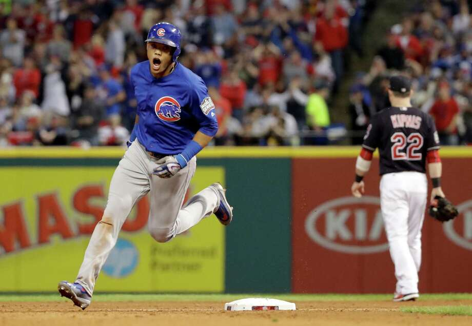 Addison Russell was a loud presence in the third inning Tuesday night, giving the Cubs a 7-0 lead with a grand slam. He had a two-run double in the first. Photo: Matt Slocum, STF / Copyright 2016 The Associated Press. All rights reserved.