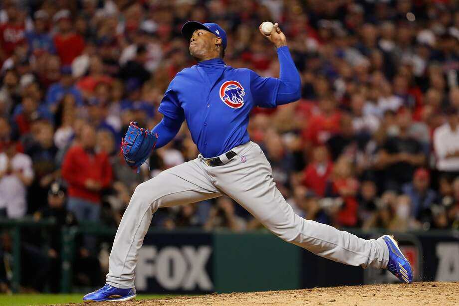CLEVELAND, OH - NOVEMBER 01:  Aroldis Chapman #54 of the Chicago Cubs throws a pitch during the seventh inning against the Cleveland Indians in Game Six of the 2016 World Series at Progressive Field on November 1, 2016 in Cleveland, Ohio.  (Photo by Jamie Squire/Getty Images) Photo: Jamie Squire, Getty Images