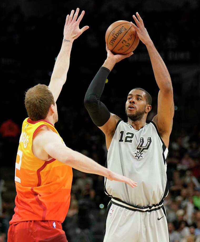 San Antonio Spurs' LaMarcus Aldridge (12) shoots against Utah Jazz's Joe Ingles during the first half of an NBA basketball game Friday, March 23, 2018, in San Antonio. (AP Photo/Darren Abate) Photo: Darren Abate, Associated Press / FR115 AP