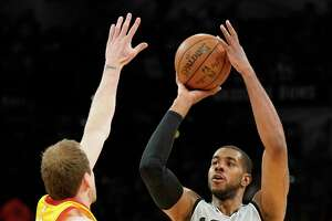 Utah Jazz' Ricky Rubio (3) drives against San Antonio Spurs' Danny Green during the second half of an NBA basketball game, Saturday, Feb. 3, 2018, in San Antonio. Utah won 120-111. (AP Photo/Darren Abate)