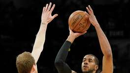 San Antonio Spurs' LaMarcus Aldridge (12) shoots against Utah Jazz's Joe Ingles during the first half of an NBA basketball game Friday, March 23, 2018, in San Antonio. (AP Photo/Darren Abate)