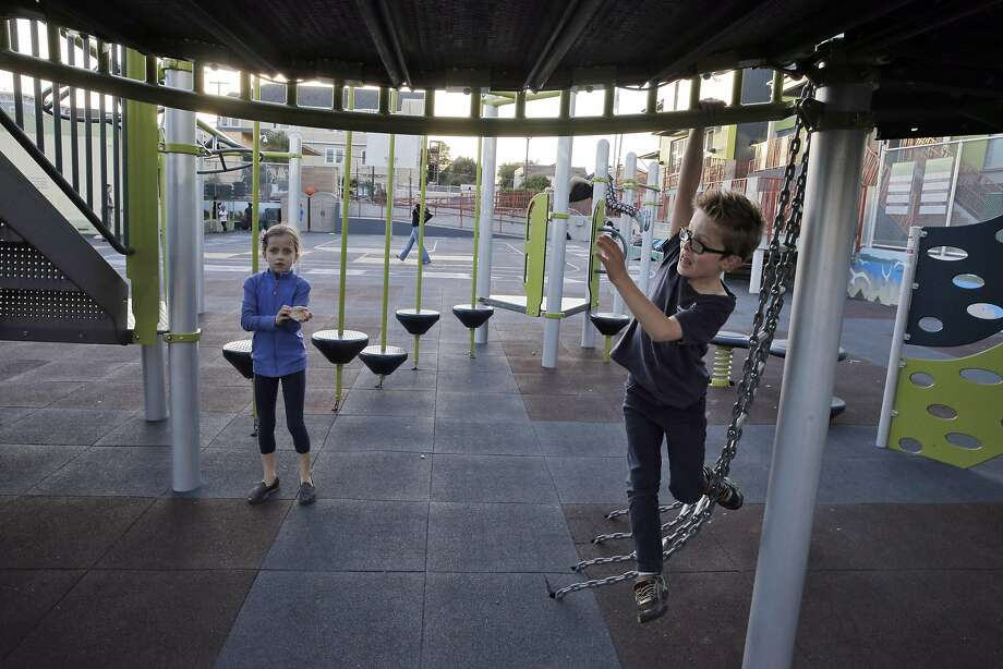 Magdalena Berthiaume and her brother, Brett, play on the jungle gym at Daniel Webster Elementary in S.F. in October. Photo: Carlos Avila Gonzalez, The Chronicle