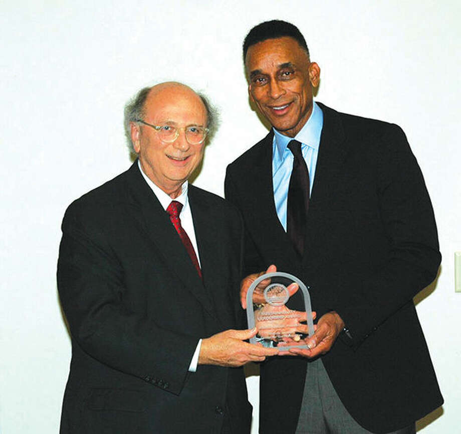 """The Sustainability Leadership Award was presented to Mr. Mannie Jackson (right) for his preservation and renovation of the Lincoln School in Edwardsville as the Mannie Jackson Center for the Humanities to """"give people a better understanding of societal differences and how we should embrace these differences."""" Dr. Dale Chapman (left), President of Lewis & Clark Community College, presented the award. Photo: For The Intelligencer"""