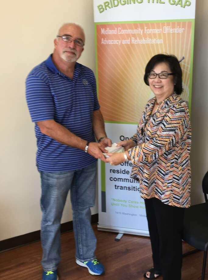 Rob Worsley, program director for the Midland Community Former Offenders Advocacy and Rehabilitation program, and Tina S. Van Dam of the Midland 100 Club.