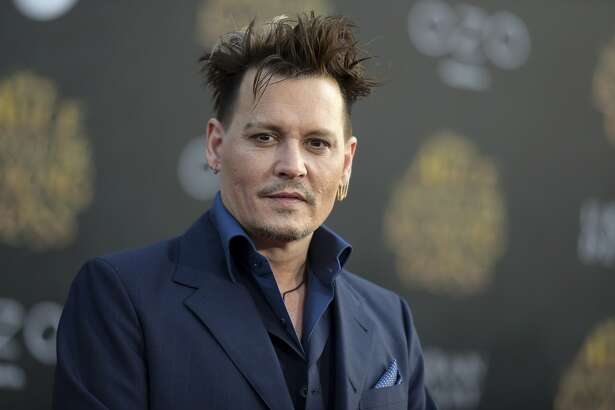 """FILE - In this May 23, 2016 file photo, Johnny Depp arrives at the premiere of """"Alice Through the Looking Glass"""" at the El Capitan Theatre, in Los Angeles. Depp is about to enter a world of magic. The actor is set to be part of """"Harry Potter"""" author J.K. Rowling's """"Fantastic Beasts and Where to Find Them"""" universe in a secretive role, according to a Warner Bros. representative Tuesday, Nov. 1, 2016. (Photo by Richard Shotwell/Invision/AP, File)"""