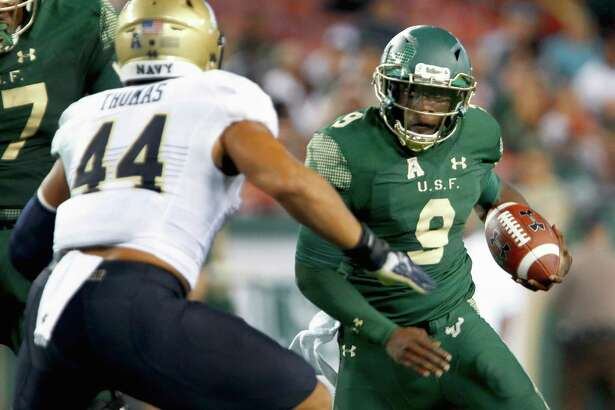 TAMPA, FL - OCTOBER 28: Quarterback Quinton Flowers #9 of the South Florida Bulls avoids a Navy Midshipmen defender during the second quarter at Raymond James Stadium on October 28, 2016 in Tampa, Florida.
