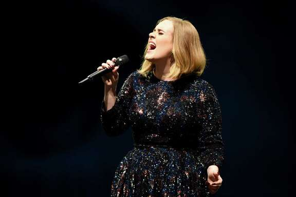 MANCHESTER, ENGLAND - MARCH 07:  Adele performs on stage at Manchester Arena on March 7, 2016 in Manchester, England.  (Photo by Gareth Cattermole/Getty Images)